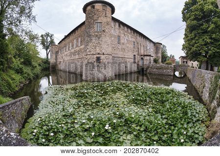 Lisignano (Piacenza Emilia Romagna Italy): the historic castle near Agazzano with waterlilies in the moat water