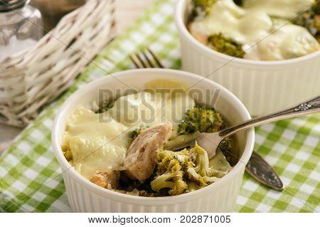 Casserole with broccoli, rice, chicken and mozzarella cheese.