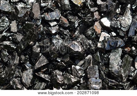 Coal anthracite of the middle fraction, as a background.