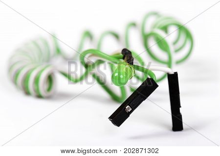 Green diode on helical conductors are isolated on white