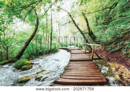Plitvice Lakes National Park, tourist route on the wooden flooring along the waterfall, Croatia