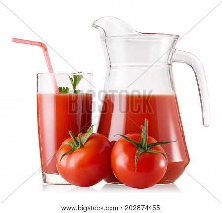 Tomato juice in a glass and a decanter and ripe tomatoes isolated on a white background
