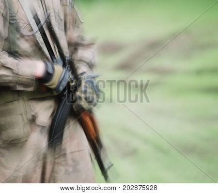 Close Up On Soldier With Machine Gun, Motion Blur