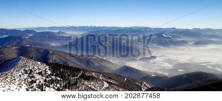 Snowy Landscape Panorama View Of Hills And Valleys From National