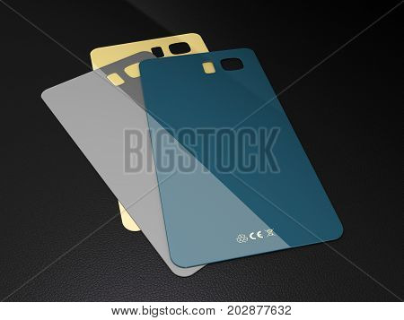 Set Of Colored Plastic Covers For Mobile Phone On A Black Background