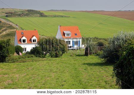 CAP GRIS NEZ, FRANCE - AUGUST 27, 2017: Colorful houses with surrounding fields in Cap Gris Nez, Cote d'Opale, Pas de Calais, Hauts de France