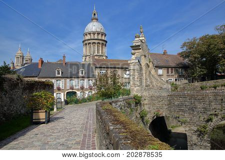 The entrance gate to the Castle Museum and the Basilica of Notre Dame in the background, Boulogne sur Mer, Cote d'Opale, Pas de Calais, Hauts de France