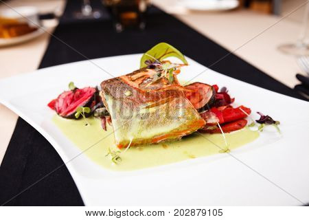 Smoked trout with vegetables on a plate