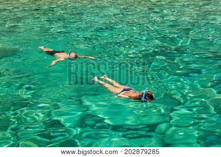 Persons Snorkeling Near Keri Blue Caves Bay  In Zakynthos (zante) Island, In Greece