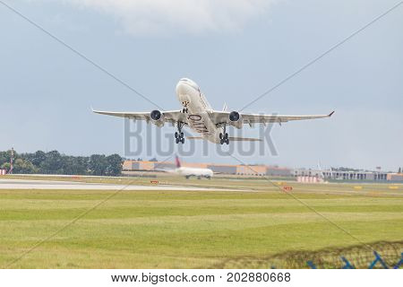 PRAGUE CZECH REPUBLIC - SEPTEMBER 03 2017: Airbus A330 of Quatar Airlines Cargo taking off from Prague airport. This aircraft has registration A7-AFV