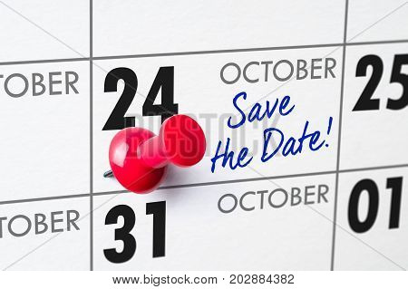 Wall Calendar With A Red Pin - October 24