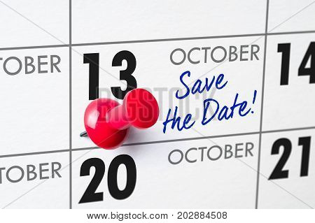 Wall Calendar With A Red Pin - October 13