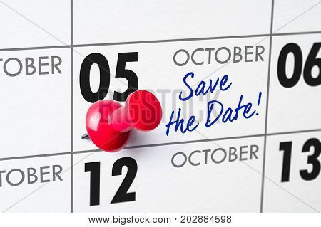 Wall Calendar With A Red Pin - October 05