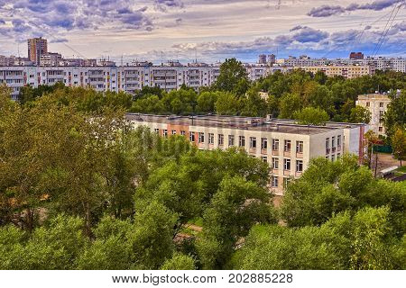View of the usual moscow school building with football field built in soviet period