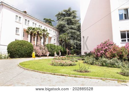 Yalta, Crimea - 11 July, Buildings in a botanical garden, 11 July, 2017. Lush vegetation of the Nikitsky Botanical Garden in the Crimea.