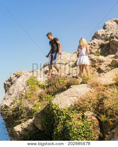 Yalta, Crimea - 11 July, Young couple on the rocks, 11 July, 2017. Small Castle Lastochkino Nest and its surroundings.