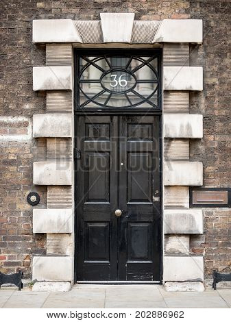 LONDON UK - 29 AUGUST 2017: A large and elaborate entrance to a period London building on Whitehall a district dominated by anonymous UK government offices.