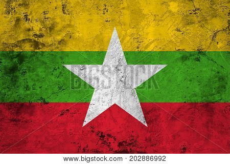 Flag of the Myanmar (Burma) against the background of the stone texture