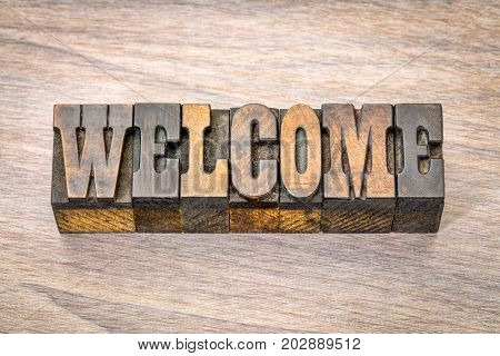 welcome banner - word  in vintage letterpress wood type, French Clarendon font popular in western movies and memorabilia