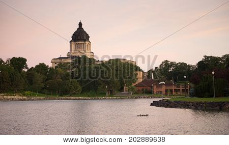 Water from the lake reflects the building in front of the capitol dome in Pierre SD