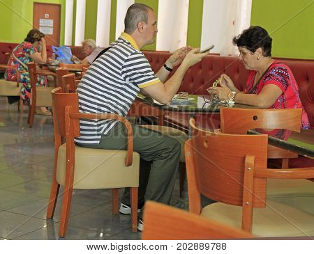 People Are Eating Cakes In Cafe