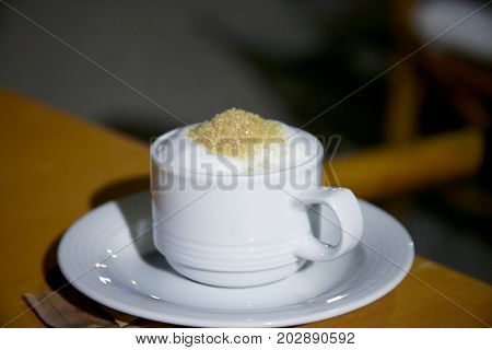 Cup of greek cappuccino on the table