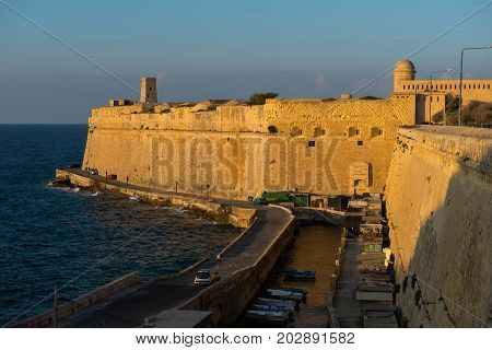Ancient Walls Of Valetta Fortification In Late Afternoon Lights