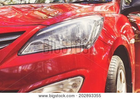 Headlight with led lamps and hood of red modern car