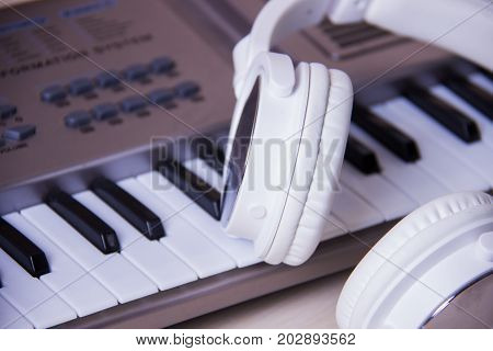 Headphones on musical synthesizer keyboard. Headphones on electronic piano