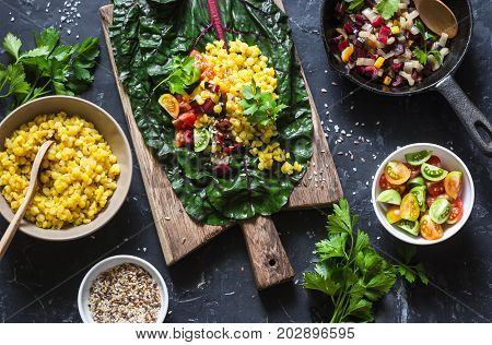 Ingredients for vegetarian chard packets. Chard leaves stuffed with turmeric lentils and vegetables. Vegetarian healthy food concept