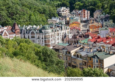 Multicolored houses surrounded by green trees. Kiev Ukraine