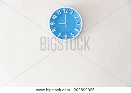 Good morning or night time with 9:00 clock on white concrete wall interior background with copy space message board concept. Good morning is the greeting in the morning 9am is the working time