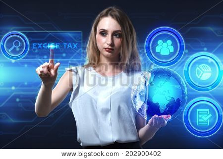 The concept of business technology the Internet and the network. A young entrepreneur working on a virtual screen of the future and sees the inscription: Excise tax