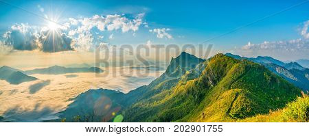Mountain landscape nature summer or spring background with sun rays blue sky Doi pha tang chiangrai thailand