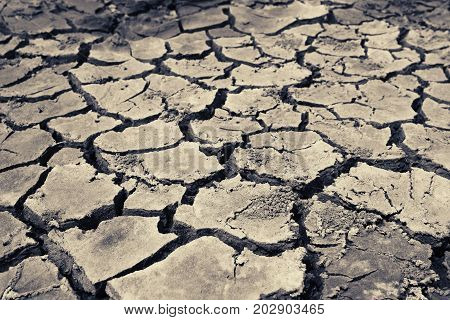 Barren earth. Dry cracked earth background. Cracked mud pattern. Soil In cracks.Drought land. Environment drought texture. Concept.