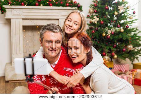 Family Taking Selfie On Christmas