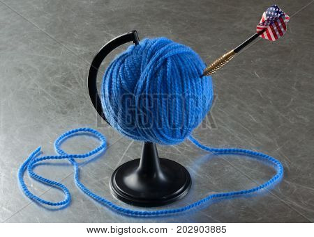 ball of yarn on a stand for the Globe pierced by an arrow