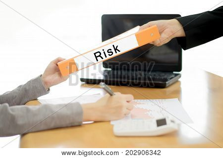 Business woman sends the debtor document to the businessman. selective focus.