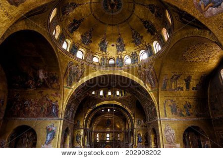 Venice, Italy - May 21, 2017: Interior of the Saint Mark`s Basilica (Basilica di San Marco). Basilica di San Marco was built in the 12th century and is the main tourist attraction of Venice.