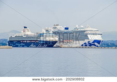 Corfu Greece - June 7 2017: Cruise liners Royal Princess and Mein Schiff 2 anchored in the harbor of Corfu island as seen from the coast.