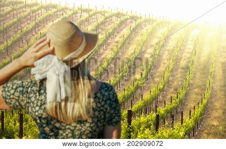 Beautiful Woman Strolling at a Winery on a Spring day.