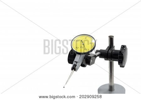 The isolate of the dial gauge and the stand .The industry measurement instrument.
