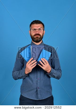 Professor With Serious Face. Man With Beard And Books