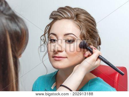 Wedding Hairstyle And Make Up.  Bride Applying Wedding Make-up