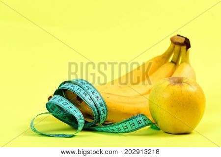 Tape For Measuring, Bunch Of Bananas And Ripe Apple,