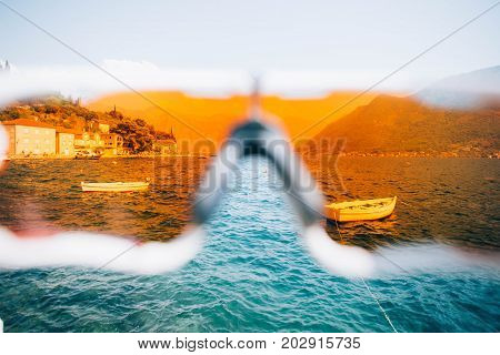 POV view on sailing boats parked in quiet bay on adriatic sea shot through lenses of action sport glasses or googles protection from UV rays