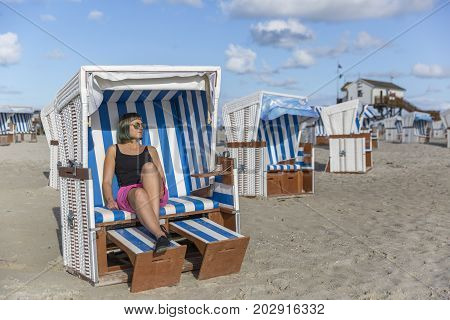 Traditional beach baskets or hooded beach chairs at Schleswig-Holstein, nothern Germany