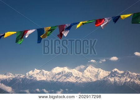 Close up of buddhist prayer flags on a sky background in Darjeeling, India.