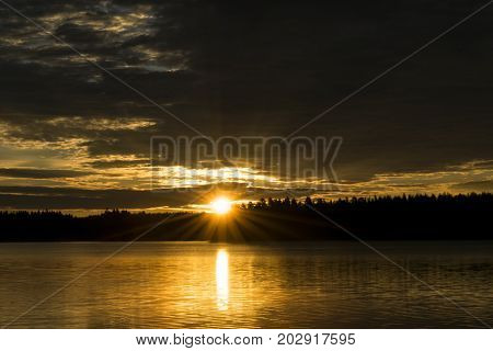 Sunset sky background. Dramatic gold sunset sky with evening sky clouds over the sea. Stunning sky clouds in the sunset. Sky landscape. Panoramic sky view.