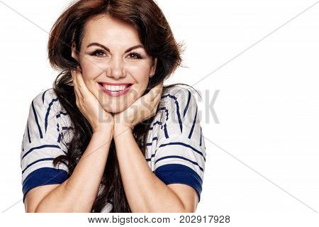 Portrait of happy successful woman triumphing with raised hands